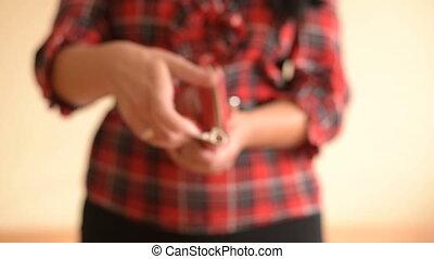 Empty purse in women's hands