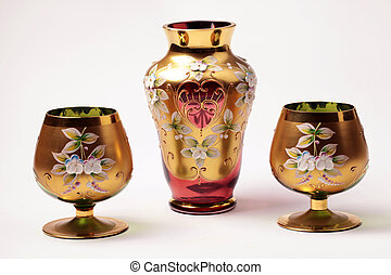 red and gold ornate glass vase and vine goblet glasses -...