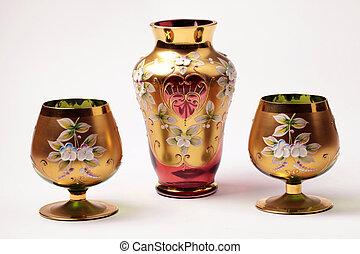 red and gold ornate glass vase and vine goblet glasses -...