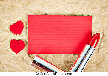 Empty red greeting card with red lipstick.