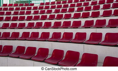 Empty red seats in amphitheater