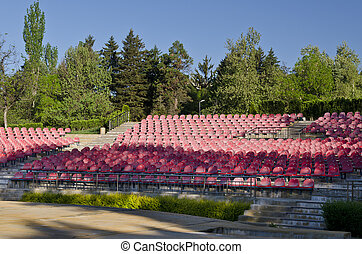 Empty red seats in an open space