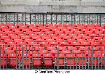 Empty red seats in stadium