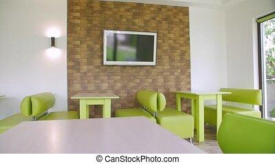 Empty restaurant in quarantine sofas and tables camera movement