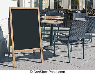 Empty restaurant menu blackboard on the street