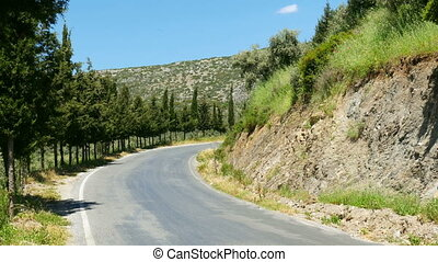 """empty road, green mountain in natural contryside, izmir, turkey"""