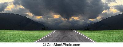 Empty road, storm clouds