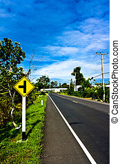Empty road with a traffic sign  in countryside of Thailand
