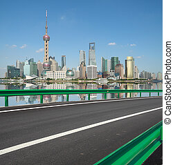 Empty road with Shanghai Lujiazui city buildings - Empty...
