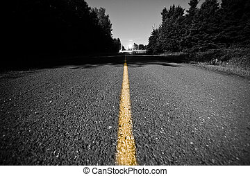 Empty Country road with Yellow Dividing line at Night