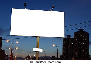 empty roadside billboards at evening in city.