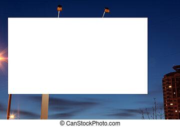 Empty roadside billboards at evening in city