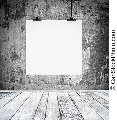 Empty room with blank paper board hanging on a wall