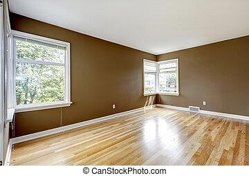 Empty room with brown walls and hardwood floor. - Empty room...