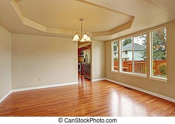 Empty room with hardwood floor - Bright empty room with...
