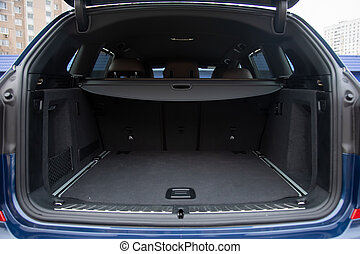 empty roomy open trunk of modern crossover car, copy space, Rear view of a car with an open trunk, close up, soft focus, blurred background