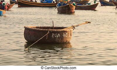 Empty Round Vietnamese Fishing Boat Floats on Sea