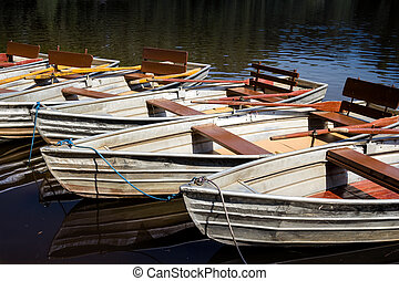 Empty rowboats at a lake in a row