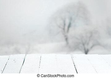 Empty rustic table in a winter landscape