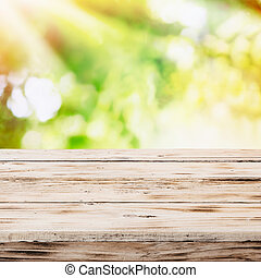 Empty rustic wooden table with golden sunlight
