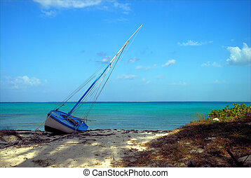 Empty Sails - Beached sailboat on the Caribbean Island of...