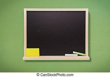 Empty school blackboard with chalk