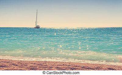 Empty sea and beach background with boat on horizon at nun, Lefkada island, Greece
