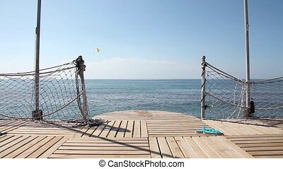 Empty sea pier - An empty wooden pier with the sea horizon