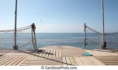 Empty sea pier - An empty wooden pier with the sea horizon
