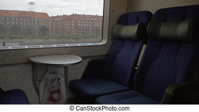 Empty seats in moving train
