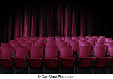 empty seats in the cinema with old red curtain background