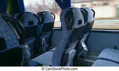 """""""Empty seats inside a low-budget bus, traveling in economy..."""