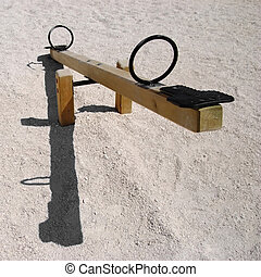 Empty seesaw - Empty wooden teeter-totter or seesaw with...