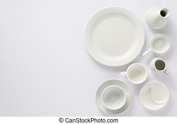 empty set of dishes on white  background, top view