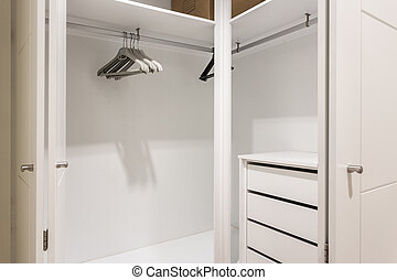 Empty shelves in the closet wardrobe for clothes.