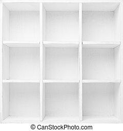 Empty Shelves in the white wooden rack