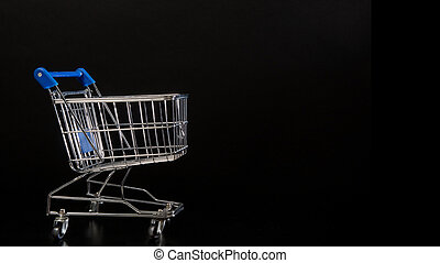 Empty shopping cart on a black background