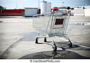 Empty shopping trolley - Color image of an abandoned...