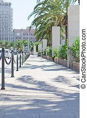 Empty sidewalk in the city center.