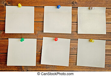 Empty six notes on wooden table