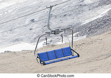 Empty ski lift above snow