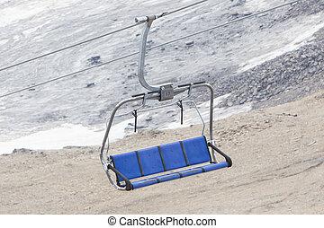 Empty ski lift above snow