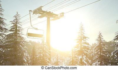 empty ski lift. chairlift silhouette on high mountain over...