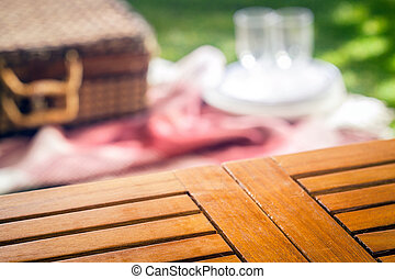 Empty slatted wooden picnic table