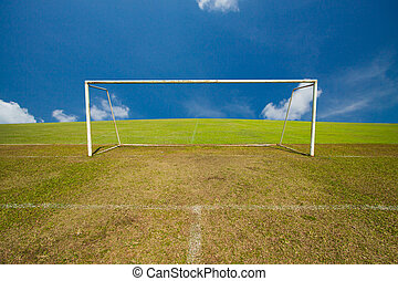 Empty soccer goal with blue sky