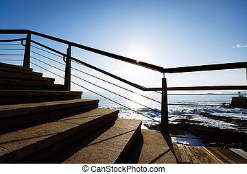 empty stairs on coast trail in the sunrise