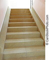 Empty stairway with tiled floor