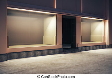 Empty storefront at night