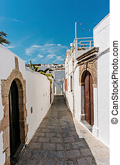 Empty street in famous town Lindos on Rhodes island -...