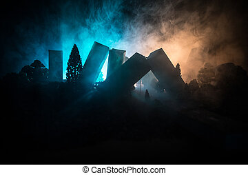 Empty street of burnt up city, flames on the ground and blasts with smoke in the distance. Apocalyptic view of city downtown as disaster film poster concept. Night scene.